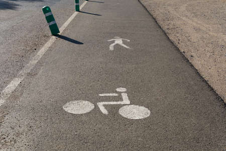 Paved road with the symbol of a cyclist and a pedestrian. Mallorca island, Spain