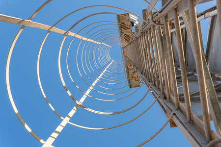 Metal staircase of a light tower of a soccer stadium. Island of Mallorca, Spain Stok Fotoğraf - 161647930