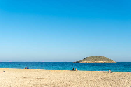 Magaluf, Spain; February 20 2021: general view of the beach of the Mallorcan resort of Magaluf on a sunny day, with families enjoying the good weather