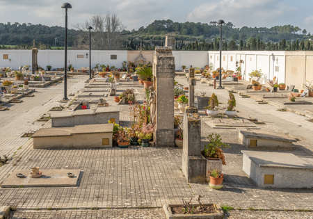 Vilafranca de Bonany, Spain; February 27 2021: general view of the interior of the municipal cemetery of the Majorcan town of Vilafranca de Bonany. Gravestones, funerary sculptures and flowers Editöryel