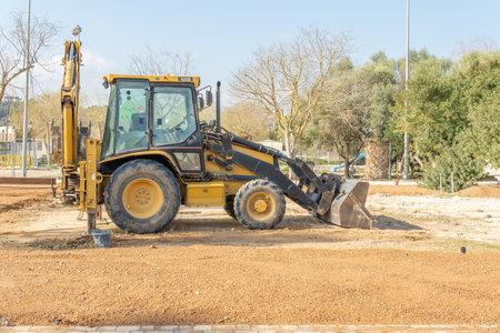 Vilafranca de Bonany, Spain; February 27 2021: excavator shovel parked in the municipal park of the Majorcan town of Vilafranca de Bonany