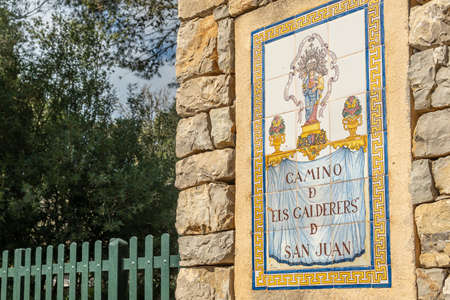 Sant Joan, Spain; February 27 2021: ceramic plaque at the entrance to the Els Calderers estate. The text says