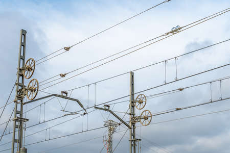 Electrical laying of a railroad track on a cloudy day