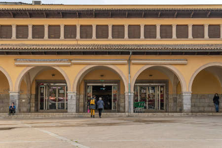 Palma de Mallorca, Spain; March 04 2021: main entrance of the traditional market called Mercat del Olivar located in the historical center of Palma de Mallorca. People wearing face masks. New normal