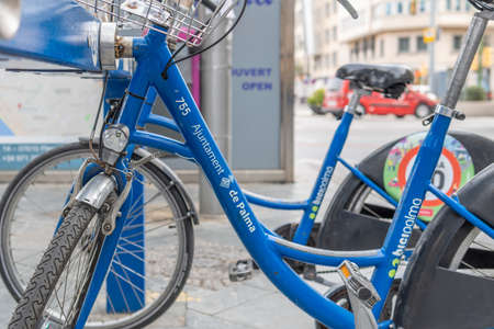 Palma de Mallorca, Spain; March 04 2021: Close-up of a parked blue bicycle, Bicipalma. Public bicycle rental system in the city of Palma de Mallorca.