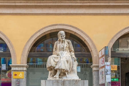 Palma de Mallorca, Spain; March 04 2021: main entrance of the traditional market called Mercat del Olivar located in the historical center of Palma de Mallorca. Anthropomorphic stone statue outdoors