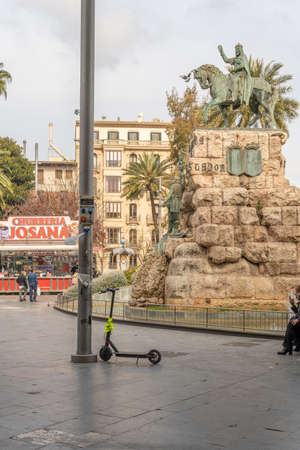 Palma de Mallorca, Spain; March 04 2021: Urabn plugs charging an electric scooter located in the Plaza de España in Palma de Mallorca, Spain