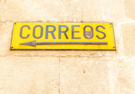 Manacor, Spain; March 18 2021: Close-up of an old poster of the company Sociedad Estatal de Correos y Telégrafos de España (Correos)