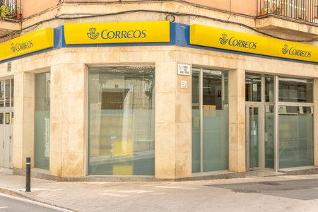 Manacor, Spain; March 18 2021: General view of an office of the company Sociedad Estatal de Correos y Telegrafos de España (Correos) in the Majorcan town of Manacor Editöryel