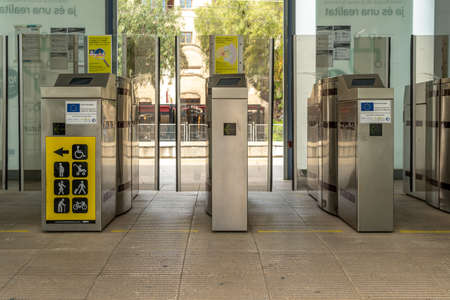Manacor, Spain; March 18 2021: General view of the interior of the train station in the Majorcan town of Manacor. Platform access door