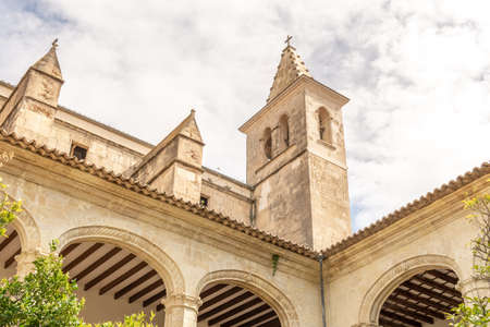 Interior of the Cloister and tower of Sant Vicenç Ferrer church, historic building that houses the municipal library of the Majorcan town of Manacor