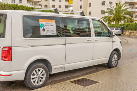 Portals Nous, Spain; March 21 2021: White van of a company that performs PCR and antigen testing for the SARS-Cov2 virus, parked on the public road. New normal