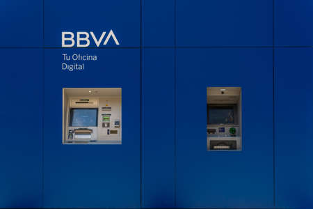 Palma de Mallorca, Spain; April 23 2021: Close-up of an ATM of a BBVA Bank on the street by daylight Editorial