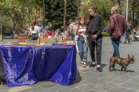 Palma de Mallorca, Spain; April 23 2021: Festivity of Sant Jordi or Book Day in the historic center of Palma de Mallorca in times of the Coronavirus pandemic. Facial mask and social distance