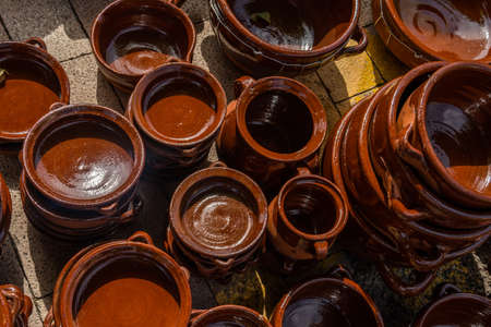 Overview of popular kitchen pottery from the island of Mallorca, Spain. Earthenware cooking pots and utensils