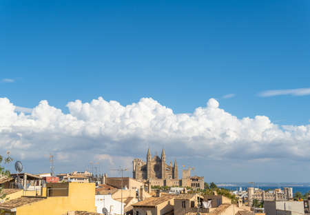 General view of the city of Palma de Mallorca with the Cathedral of Palma in the background at sunset