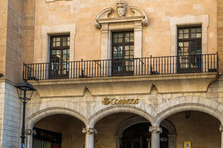 Palma de Mallorca, Spain; September 10 2021: Main facade of the Spanish state-owned postal company Correos at its headquarters in the city of Palma de Mallorca