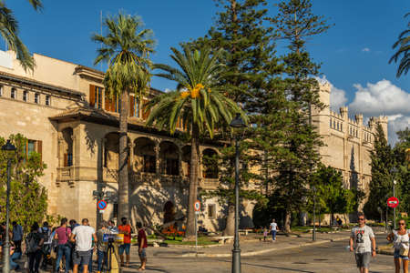 Palma de Mallorca, Spain; September 10 2021: General view of the public building El Consolat de Mar, seat of the Balearic government, next to the gothic building La Lonja at sunset, Palma de Mallorca