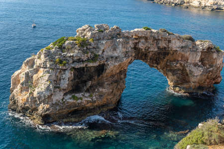 Es Pontas rock formation on the south coast of the island of Mallorca at sunrise. Tourist attraction of the wild nature of the Mediterranean sea Stock Photo