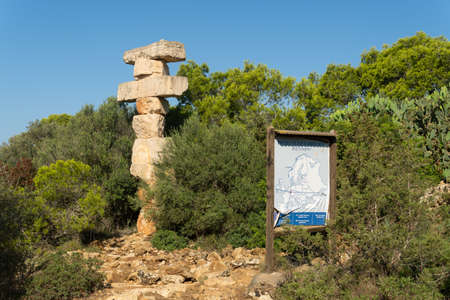 Cala Santanyi, Spain; September 11 2021: Monolith of superimposed stones belonging to the project south balance Rolf Schaffner, in the Majorcan town of Cala Santanyi on a sunny day