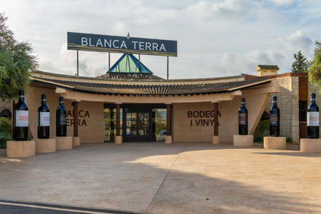 Montuiri, Spain; September 18 2021: Main entrance of the winery Blanca Terra in the Majorcan town of Montuiri, at dawn. Advertising text written in Catalan language