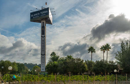 Montuiri, Spain; September 18 2021: Monopost with billboard of the winery Blanca Terra in the Majorcan town of Montuiri, at dawn. Advertising text written in Catalan language