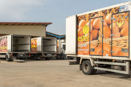 Manacor, Spain; September 25 2021: Main facade of the hen egg company Avicola Ballester with delivery trucks parked at the entrance in the Majorcan town of Manacor