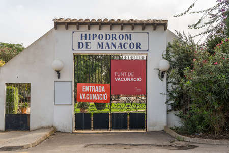 Manacor, Spain; September 25 2021: Poster of the municipal Hippodrome of the Majorcan town of Manacor written in Catalan language. Currently Covid-19 vaccination center