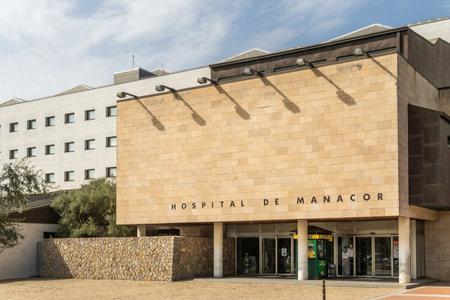 Manacor, Spain; September 25 2021: Main facade of Manacor Hospital on a sunny morning on the island of Mallorca, Spain
