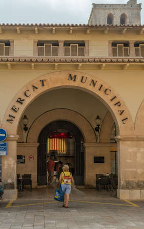 Felanitx. Spain; September 25 2021: Main entrance of the Municipal Market of the Majorcan town of Felanitx, island of Mallorca. Image of the local commerce in small towns Editorial