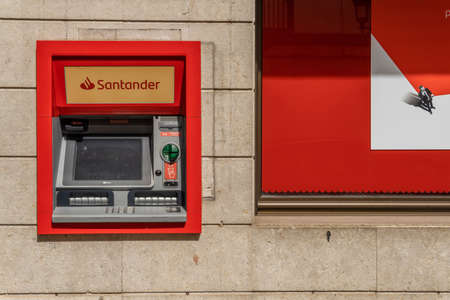 Felanitx, Spain; September 25 2021: Close-up of an ATM of a Santander Bank on the street by daylight