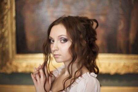 Romantic portrait of young beautiful lady in palace