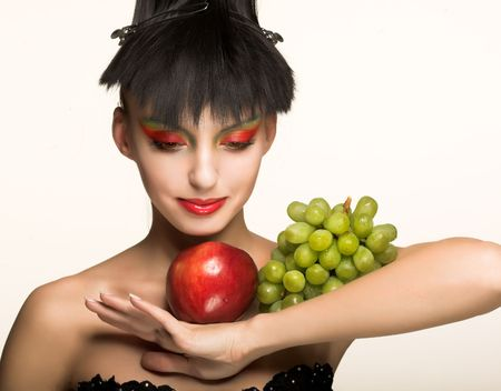 Portrait of young girl witn fresh fruit's Stock Photo - 4788451