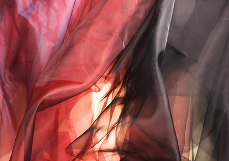 organza: Black and red silk fabric. Beautiful artistic background.
