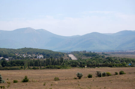midday: The ridge of the Crimean mountains and the valley at sunny summer midday Stock Photo