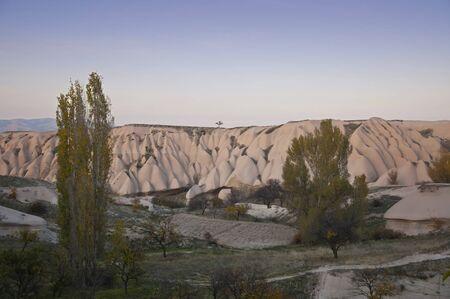 sediments: The sediments of volcanic tuff in Cappadocia near the Uchisar Castle in the evvening Stock Photo