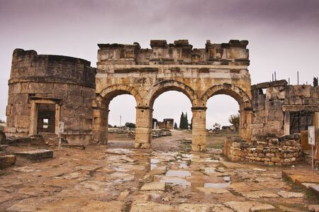hierapolis: The ruins of entrance gate of ancient Hierapolis at cloudy day