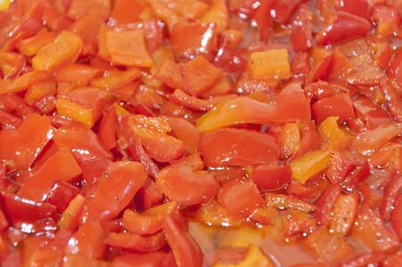 red braised: Chops of braised red bell pepper in oil close up