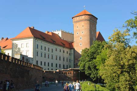 senators: Krakow, Poland - July 2, 2015 : Tourists walk around the Royal Wawel Castle near to the Senators tower