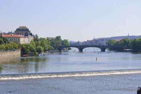 midday: Legion Bridge, Vltava river and the central part of Prague at sunny summer midday Stock Photo