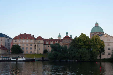 vltava: The view of Knights Cross Monastery in Prague from the Vltava river