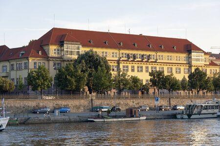 vltava: Prague, Czech - 03 July, 2015: Building of Hospital Na Frantisku and embankment of Vltava