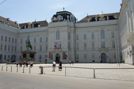 hofburg: Vienna, Austria - 04 July 2015 : The building of National Austrain Library (former Imperial Library) - largest library in Austria. This Library has 7.4 million items in various collection and its bulding is the part of Hofburg Imperial Palace
