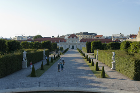 Vienna, Austria - 04 July 2015 : Rare visitors walking in the park of Belvedere museum - former residence of Prince Eugene of Savoy Редакционное
