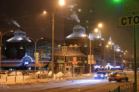 kharkov: Kharkov, Ukraine - 08 January, 2017 : Building of the Sumskoy Market and Trinklera street at the evening Editorial