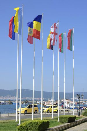 flagstaff: Nesebar, Bulgaria - 21 Juny, 2016 : Flags of different countries on the flagstoff in Old Nesebar