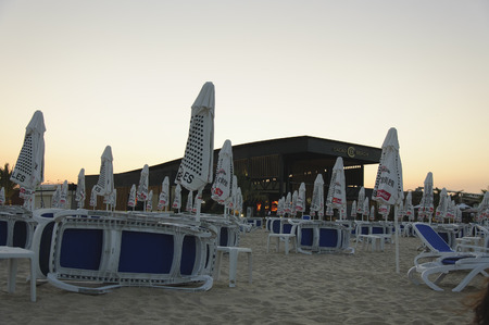 Sunny Beach, Bulgaria - 22 Juny 2016: Chaise lounges and parasols near night club Cacao Beach