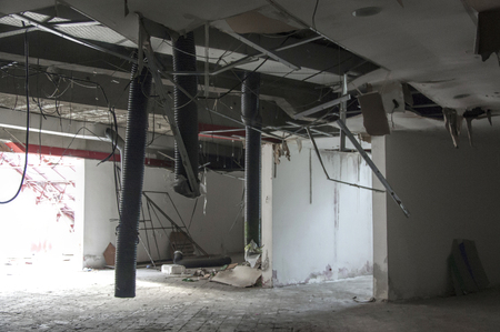 Tirana, Albania - 16 July 2017 : Damaged pipelines inside the Pyramyd of Tirana - former museum of albanian dictator Enver Hoxha Редакционное