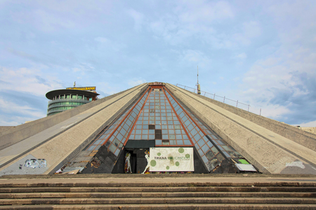 Tirana, Albania - 16 July 2017 : The Pyramid of Tyrana - peculiar architectural structure in the centre of the city. Since its opening in 1988 Pyramid perfomed function of Enver Hoxha museum, conference center, exhibiton venue, NATO base, TV broadcasting
