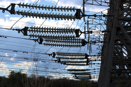 The row of electric pylons with link-strain insulators Фото со стока